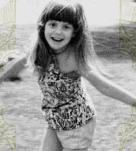 Jamie Della at 5 dancing with a palm tree suring a Santa Ana wind